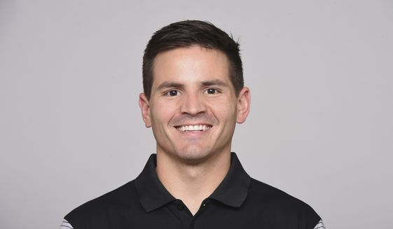 Michigan hired Baltimore Ravens linebacker coach Mike Macdonald as defensive coordinator. (AP Photo)