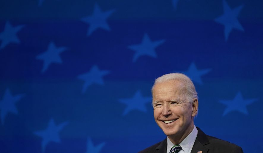 FILE - In this Jan. 16, 2021, file photo President-elect Joe Biden speaks during an event at The Queen theater in Wilmington, Del. (AP Photo/Matt Slocum, File)
