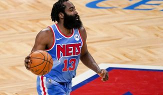 Brooklyn Nets guard James Harden handles the ball during the first half of an NBA basketball game against the Orlando Magic, Saturday, Jan. 16, 2021, in New York. (AP Photo/Mary Altaffer)