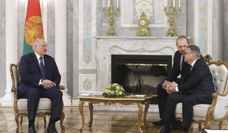 Belarusian President Alexander Lukashenko, left, speaks with International Ice Hockey Federation President Rene Fasel during their meeting in Minsk, Belarus, Monday, Jan. 11, 2021. (Nikolai Petrov/BelTA Pool Photo via AP)