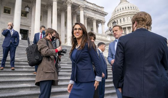 In this Jan. 4, 2021, file photo, Rep. Lauren Boebert, R-Colo., center, joins other freshman Republican House members for a group photo at the Capitol in Washington. (AP Photo/J. Scott Applewhite, File)