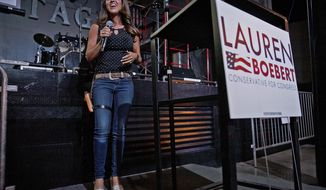 FILE - In this June 30, 2020, file photo, Lauren Boebert speaks during a watch party at Warehouse 25 Sixty Five in Grand Junction, Colo., after polls closed in Colorado's primary election. Bri Buentello, a former state representative in Colorado, sued Boebert on Sunday, Jan. 17, 2021, after being blocked from the first-term federal lawmaker's Twitter account. (McKenzie Lange/The Grand Junction Daily Sentinel via AP, File)