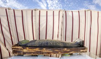 CORRECTS DAY OF WEEK TO SUNDAY -- A trove of ancient coffins and artifacts on display that Egyptian archaeologist Zahi Hawass and his team unearthed in a vast necropolis, in Saqqara, south of Cairo, Egypt, Sunday, Jan. 17, 2021. (AP Photo/Nariman El-Mofty)