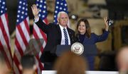 Vice President Mike Pence, left, and second lady Karen Pence wave following remarks to Army 10th Mountain Division soldiers, many of whom have recently returned from Afghanistan, in Fort Drum, N.Y., Sunday, Jan. 17, 2021. (AP Photo/Adrian Kraus)