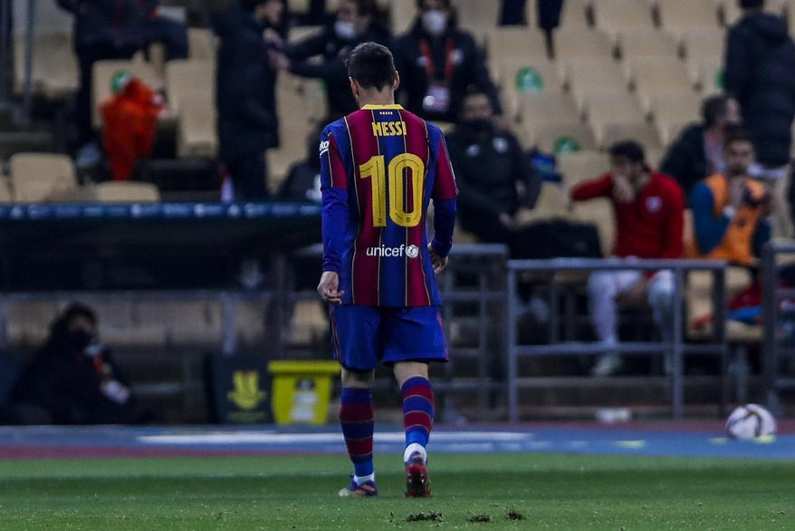 Barcelona's Lionel Messi walks out of the pitch after being shown a red card during the Spanish Supercopa final soccer match against FC Barcelona at La Cartuja stadium in Seville, Spain, Sunday, Jan. 17, 2021. (AP Photo/Miguel Morenatti)