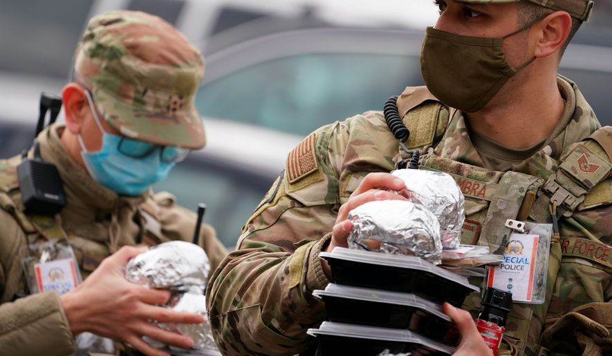 Downtown restaurants in the District are giving food to the National Guard troops. The troops have been patrolling the District in preparation for Inauguration Day. (Associated Press)