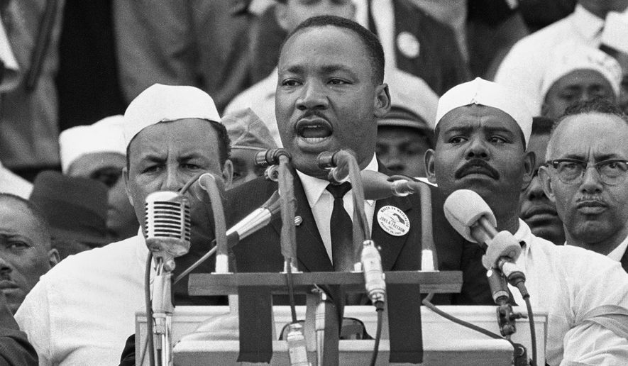 Traditional observations of Martin Luther King Jr.'s birthday were toned down and transformed into online events or face-to-face acts of service with health measures put in place. This year marks what would have been the civil rights leader's 92nd birthday. (ASSOCIATED PRESS)