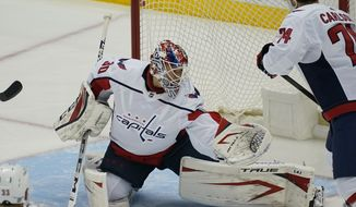 Washington Capitals goaltender Ilya Samsonov blocks a shot during the first period of an NHL hockey game against the Pittsburgh Penguins in Pittsburgh, Sunday, Jan. 17, 2021. (AP Photo/Gene J. Puskar) **FILE**