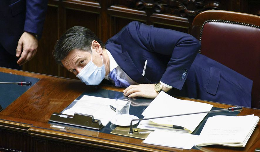 Premier Giuseppe Conte waits for the outcome of the confidence vote at the lower chamber of Parliament, in Rome, Monday, Jan. 18, 2021. Conte fights for his political life with an address aimed at shoring up support for his government, which has come under fire from former Premier Matteo Renzi's tiny but key Italia Viva (Italy Alive) party over plans to relaunch the pandemic-ravaged economy. (Guglielmo Mangiapane/Pool photo via AP)