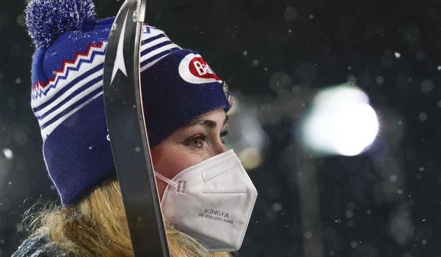 United States' Mikaela Shiffrin wears a face mask as she waits for the podium ceremony after winning an alpine ski, women's World Cup slalom in Flachau, Austria, Tuesday, Jan. 12, 2021. (AP Photo/Giovanni Auletta)