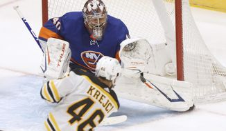 New York Islanders goalie Semyon Varlamov (40), of Russia, saves a shot from Boston Bruins' David Krejci (46), of the Czech Republic, during the second period of an NHL hockey game Monday, Jan. 18, 2021, in Uniondale, N.Y. (AP Photo/Jason DeCrow)