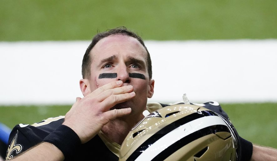New Orleans Saints quarterback Drew Brees waves to his family and fans after an NFL divisional round playoff football game against the Tampa Bay Buccaneers, Sunday, Jan. 17, 2021, in New Orleans. The Buccaneers won 30-20. (AP Photo/Brynn Anderson) **FILE**