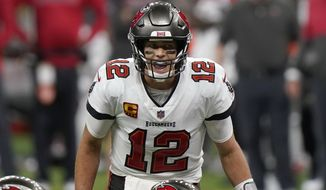 Tampa Bay Buccaneers quarterback Tom Brady (12) calls a play at the line of scrimmage against the New Orleans Saints during the second half of an NFL divisional round playoff football game, Sunday, Jan. 17, 2021, in New Orleans. (AP Photo/Brynn Anderson)