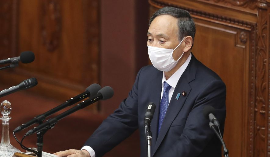 Japanese Prime Minister Yoshihide Suga delivers a policy speech during an ordinary Diet session at the upper house of parliament in Tokyo, Monday, Jan. 18, 2021. (AP Photo/Koji Sasahara)