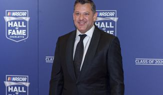 FILE - NASCAR Hall of Fame inductee Tony Stewart poses for pictures prior to the induction ceremony in Charlotte, N.C., in this Friday, Jan. 31, 2020, file photo. Tony Stewart wants to set the record straight about two misconstrued recent business decisions. Fans have been critical of Stewart since the Truck Series was dropped from Eldora Speedway and because he didn't sign Kyle Larson to his NASCAR team. Stewart is adamant that he tried to sign Larson but couldn't get partner approval on the driver suspended for using a racial slur. And he insists he dropped NASCAR after he felt slighted that Bristol Motor Speedway was given a Cup race on dirt. (AP Photo/Mike McCarn, File)