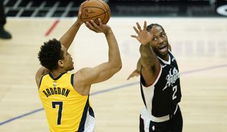 Indiana Pacers guard Malcolm Brogdon (7) shoots against Los Angeles Clippers forward Kawhi Leonard (2) during the first quarter of an NBA basketball game, Sunday, Jan. 17, 2021, in Los Angeles. (AP Photo/Ashley Landis)