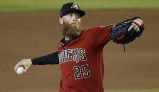 FILE - Arizona Diamondbacks pitcher Archie Bradley throws a pitch during an intrasquad game at Chase Field in Phoenix, in this Monday, July 6, 2020, file photo. Reliever Archie Bradley and the Philadelphia Phillies finalized their $6 million, one-year contract on Monday, Jan. 18, 2021. (AP Photo/Ross D. Franklin, FIle)