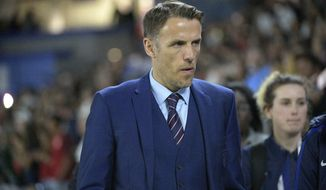 FILE - In this Wednesday, March 7, 2018 file photo, England head coach Phil Neville walks onto the field before a SheBelieves Cup women's soccer match against the United States, in Orlando, Fla. Neville is leaving his job as coach of England's women's team ahead of an anticipated switch to men's soccer in the United States, it was announced Monday, Jan. 18, 2021. The Football Association has released Neville from his contract immediately after being informed he was in talks to become coach of Inter Miami, the Major League Soccer franchise partly owned by David Beckham.  (AP Photo/Phelan M. Ebenhack, file)