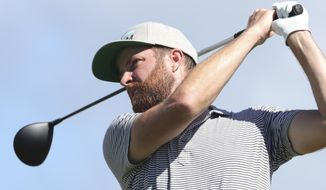Chris Kirk follows his shot off the first tee during the third round at the Sony Open golf tournament Saturday, Jan. 16, 2021, in Honolulu. (AP Photo/Marco Garcia)