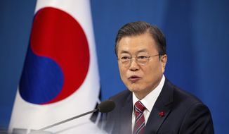 South Korean President Moon Jae-in speaks during an on-line New Year press conference with local and foreign journalists at the Presidential Blue House in Seoul, South Korea Monday, Jan. 18, 2021. (Jeon Heon-kyun/Pool Photo via AP)