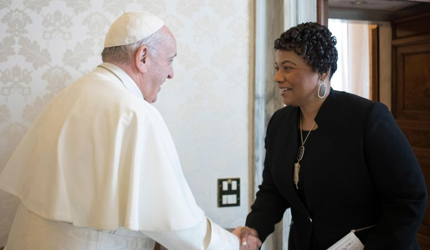 """FILE - In this March 12, 2018 file photo, youngest child of civil rights leaders Martin Luther King Jr. Bernice King is welcomed by Pope Francis on the occasion of their private audience at the Vatican. Francis sent a message of prayer Monday to King's daughter, the Rev. Bernice King, with whom the pontiff met in 2018. He called for unity, not division and extinguishing hatred and """"not holding onto it."""" (L'Osservatore Romano/Pool Photo via AP)"""