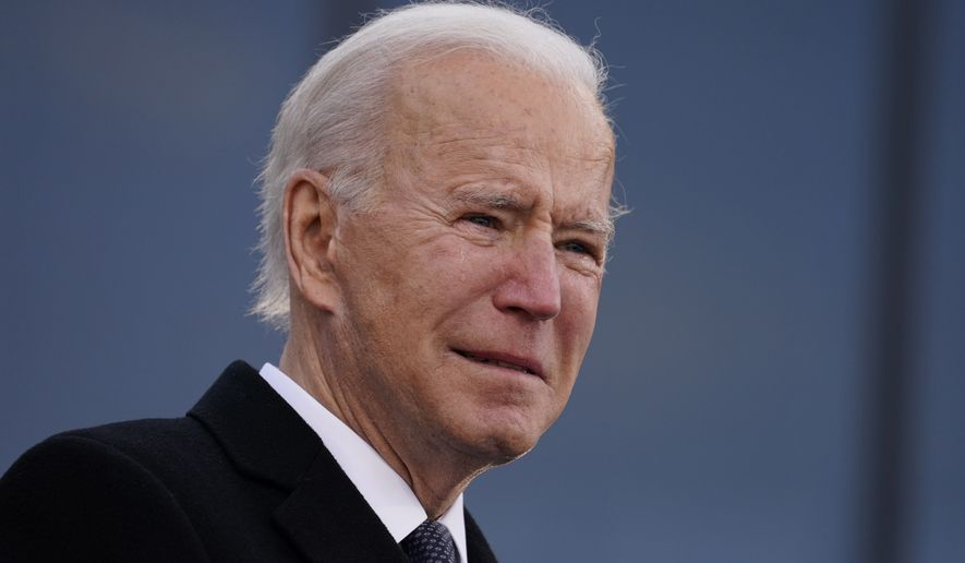 "President-elect Joe Biden tears up as he speaks at the Major Joseph R. ""Beau"" Biden III National Guard/Reserve Center, Tuesday, Jan. 19, 2021, in New Castle, Del. (AP Photo/Evan Vucci)"