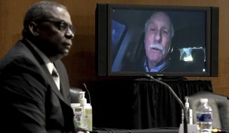 Sen. Angus King, I-Maine, appears virtual to ask questions during a confirmation hearing for Secretary of defense nominee Lloyd Austin, a recently retired Army general, before the Senate Armed Services Committee on Capitol Hill, Tuesday, Jan. 19, 2021, in Washington. King is en route to Washington to attend the inauguration of President-elect Joe Biden. (Greg Nash/Pool via AP)