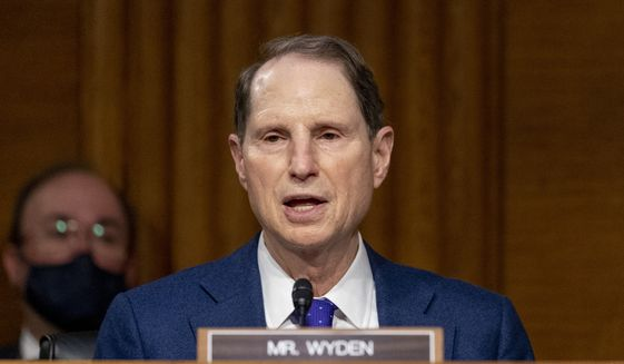 Ranking Member Ron Wyden, D-Ore., speaks during a Senate Finance Committee hearing to examine the expected nomination of Janet Yellen to be secretary of the Treasury on Capitol Hill in Washington, Tuesday, Jan. 19, 2021. (AP Photo/Andrew Harnik, Pool)