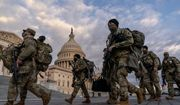 Armed National Guard troops walk past the U.S. Capitol two days before the 59th Presidential Inauguration in Washington, Monday, Jan. 18, 2021. (AP Photo/Andrew Harnik)