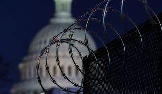 Riot fencing and razor wire reinforce the security zone on Capitol Hill in Washington, Tuesday, Jan. 19, 2021, before President-elect Joe Biden is sworn in as the 46th president on Wednesday. (AP Photo/J. Scott Applewhite)