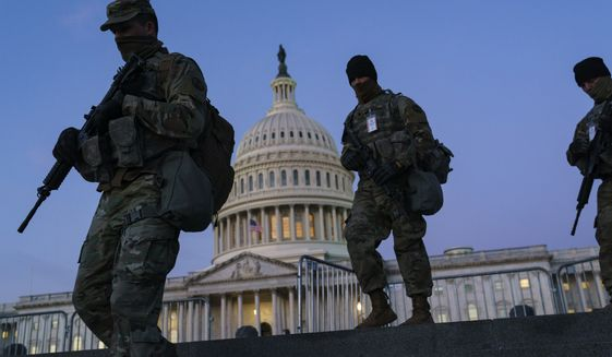 National Guard troops reinforce the security zone on Capitol Hill in Washington, Tuesday, Jan. 19, 2021, before President-elect Joe Biden is sworn in as the 46th president on Wednesday. (AP Photo/J. Scott Applewhite)