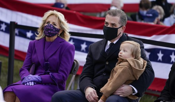 """President-elect Joe Biden's wife Jill Biden sits with Hunter Biden and his child during an event at the Major Joseph R. """"Beau"""" Biden III National Guard/Reserve Center, Tuesday, Jan. 19, 2021, in New Castle, Del. (AP Photo/Evan Vucci) **FILE**"""