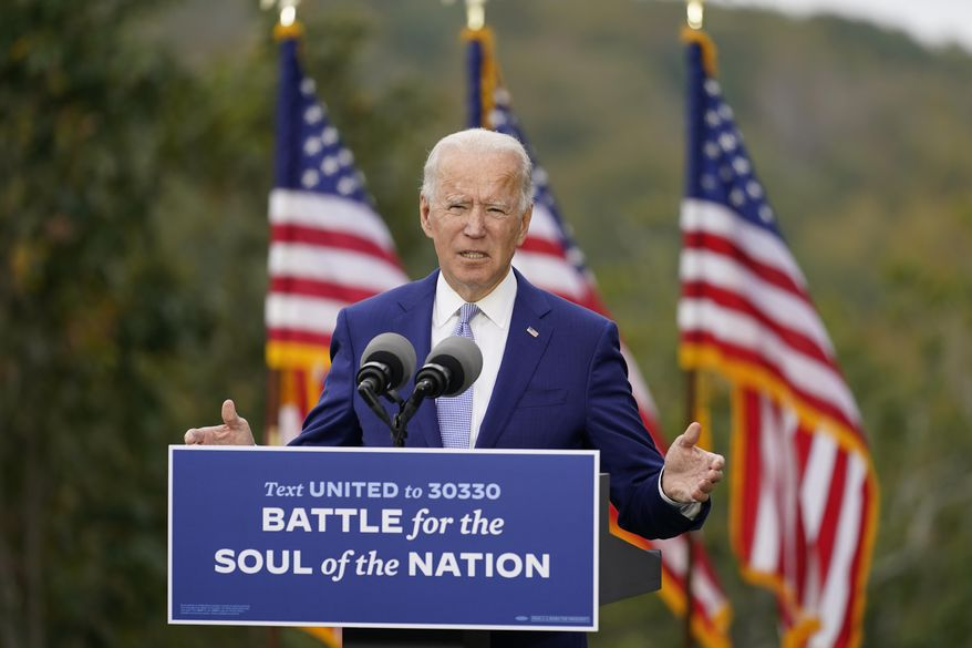 FILE - In this Oct. 27, 2020, file photo, then-Democratic presidential candidate former Vice President Joe Biden speaks at Mountain Top Inn & Resort in Warm Springs, Ga. President-elect Joe Biden has evoked Franklin Delano Roosevelt in promising a remaking of America unseen since the New Deal. Pledging to emulate some of the loftiest reforms in the nation's history has left him with towering promises to keep. And Biden hopes to deliver against the backdrop of the pandemic and searing national division. (AP Photo/Andrew Harnik, File)
