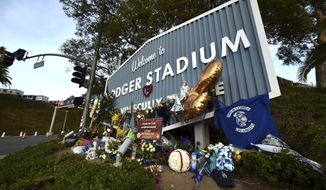 A makeshift memorial along Vin Scully Way in front of Dodger Stadium in Los Angeles on Wednesday, Jan. 13, 2021, honors former Los Angeles Dodgers manager Tommy Lasorda, who died last week. (Keith Birmingham/The Orange County Register via AP)