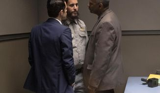 """This image released by Warner Bros. Pictures shows Rami Malek, from left, Jared Leto and Denzel Washington in a scene from """"The Little Things."""" (Nicola Goode/Warner Bros Pictures via AP)"""
