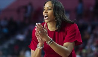 """File-This Nov. 17, 2019, file photo shows Georgia coach Joni Taylor shouting to players during an NCAA women's basketball game against Georgia Tech in Athens, Ga. The Georgia Lady Bulldogs are back in the Top 25. """"That's a part of Georgia basketball. That's the expectation,"""" coach Joni Taylor said Tuesday. """"You can't walk into the building and not be reminded of who we are, the program's history, and what we're trying to carve out in terms of women's basketball. That's a huge motivator for me, my entire staff, and all the ladies we bring in to play here."""" (AP Photo/John Amis, File)"""