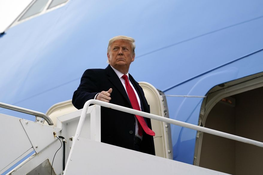 In this Tuesday, Jan. 12, 2021, photo, President Donald Trump gestures as he boards Air Force One upon arrival at Valley International Airport, in Harlingen, Texas. (AP Photo/Alex Brandon) ** FILE **