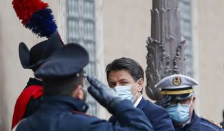 Premier Giuseppe Conte arrives at the Senate do deliver his speech, in Rome, Tuesday, Jan. 19, 2021. Conte fights for his political life with an address aimed at shoring up support for his government, which has come under fire from former Premier Matteo Renzi's tiny but key Italia Viva (Italy Alive) party over plans to relaunch the pandemic-ravaged economy. (AP Photo/Alessandra Tarantino)