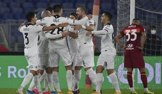 Spezia's Riccardo Saponara celebrates scoring with teammates during the Italian Cup, round of 16 soccer match between Roma and Spezia at the Olympic stadium in Rome, Tuesday, Jan. 19, 2021. (Alfredo Falcone/LaPresse via AP)