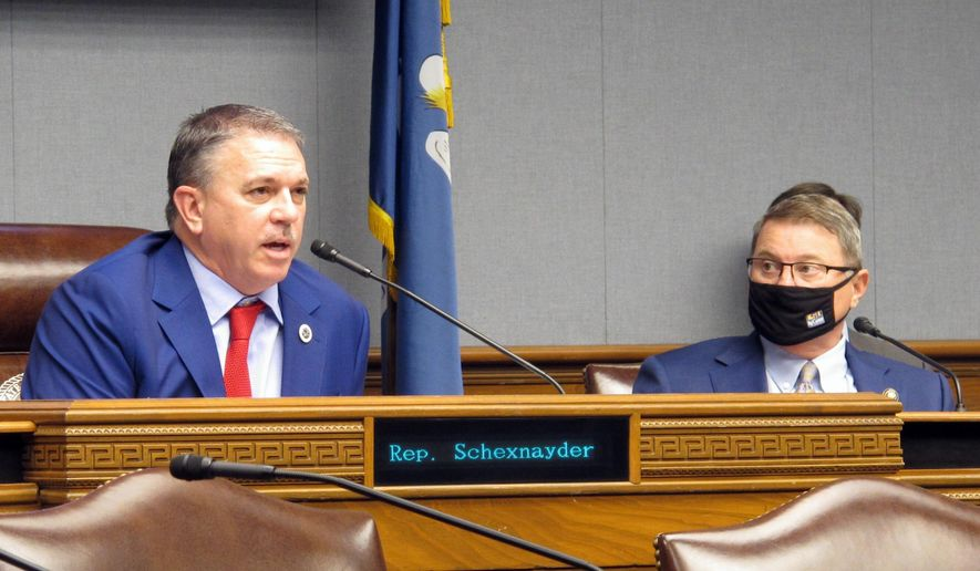House Speaker Clay Schexnayder, R-Gonzales, left, asks questions during a meeting of Louisiana's income forecasting panel, the Revenue Estimating Conference, while Senate President Page Cortez, R-Lafayette, listens on Tuesday, Jan. 19, 2021, in Baton Rouge, La. (AP Photo/Melinda Deslatte)