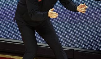 Rutgers head coach Steve Pikiell directs his team against Ohio State during the second half of an NCAA college basketball game Saturday, Jan. 9, 2021, in Piscataway, N.J. Ohio State won 79-68. (AP Photo/Adam Hunger)