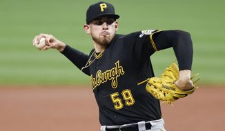 FILE - In this Sept. 26, 2020, file photo, Pittsburgh Pirates starting pitcher Joe Musgrove delivers against the Cleveland Indians during the first inning of a baseball game in Cleveland. The San Diego Padres are adding yet another pitcher to their rotation, agreeing to bring right-hander Musgrove to his hometown in a trade with the Pirates, according to a person familiar with the deal.  (AP Photo/Ron Schwane, file)