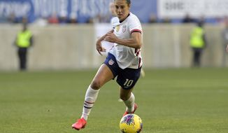 File-This March 8, 2020, file photo shows the United States forward Carli Lloyd (10) during the first half of a SheBelieves Cup soccer match against Spain in Harrison, N.J. Far from deterred by a lengthy layoff after getting her left knee scoped, Lloyd is back with a steadfast resolve as the U.S. national team pushes toward the Tokyo Olympics.  (AP Photo/Bill Kostroun, File)