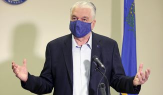 FILE - In this Oct. 2, 2020, file photo, Nevada Gov. Steve Sisolak speaks during a news conference at the Sawyer Building in Las Vegas. Sisolak laid out ambitious plans Tuesday, Jan. 19, 2021, to create programs to spur job growth and attract new industries to Nevada as the coronavirus pandemic continues to wreak havoc on the state's tourism-driven economy. (K.M. Cannon/Las Vegas Review-Journal via AP, Pool, File)