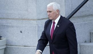 Vice President Mike Pence walks to the West Wing of the White House after addressing staff on the steps of the Eisenhower Executive Office Building, in the White House complex, Tuesday, Jan. 19, 2021, in Washington. (AP Photo/Gerald Herbert) ** FILE **