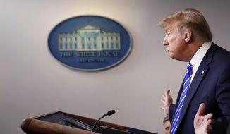 In this April 23, 2020, file photo, President Donald Trump speaks about the coronavirus in Washington. (AP Photo/Alex Brandon, File)