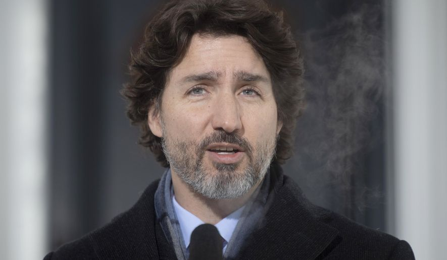Canadian Prime Minister Justin Trudeau speaks during a news conference outside Rideau cottage in Ottawa, Ontario, Tuesday, Jan. 19, 2021. (Adrian Wyld/The Canadian Press via AP)
