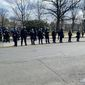 A line of helmeted U.S. Capitol Police officers with guns, batons and zip tie handcuffs stood in the middle of North Capitol Street NW just moments before President Joseph R. Biden took his oath of office on Wednesday, Jan. 20, 2021. (Emily Zantow / The Washington Times)