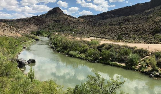 FILE - This Aug. 6, 2018, file photo shows the Rio Grande flowing south of Taos, New Mexico. Democratic state senators are seeking to strengthen protections for the environment and natural resources through a joint resolution that seeks to amend the state constitution and bring New Mexico in line with numerous other states that already guarantee residents rights to clean air and water. (AP Photo/Susan Montoya Bryan, File)
