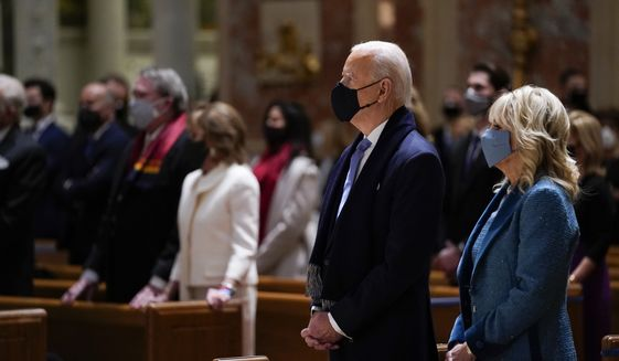 President-elect Joe Biden and his wife Jill Biden attend Mass at the Cathedral of St. Matthew the Apostle during Inauguration Day ceremonies Wednesday, Jan. 20, 2021, in Washington.(AP Photo/Evan Vucci)